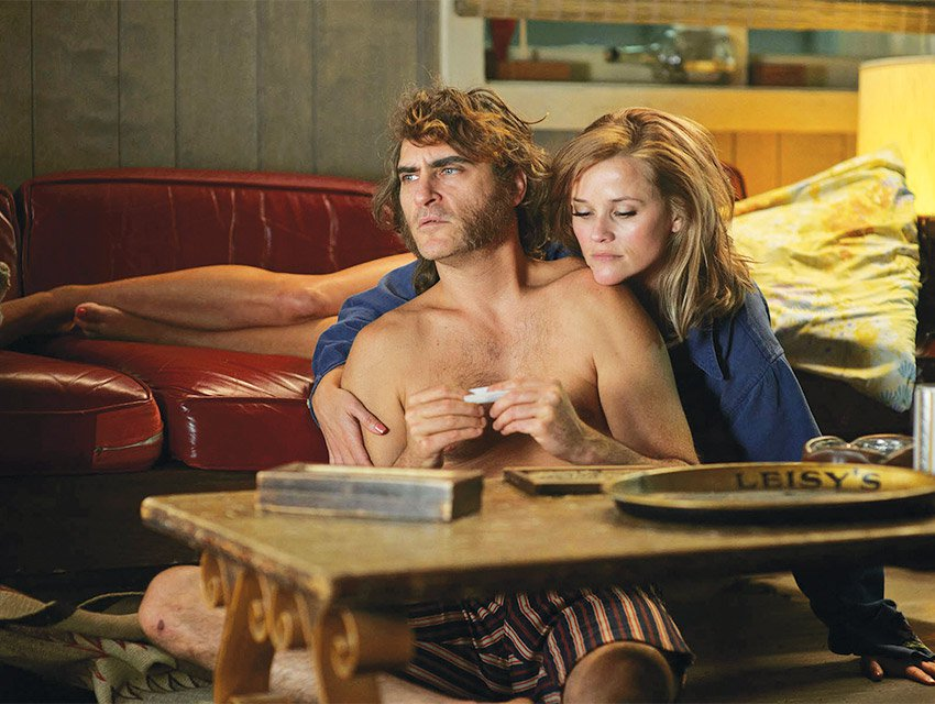 Phoenix and Reese Witherspoon in Inherent Vice. Photograph by Wilson Webb/Warner Bros.